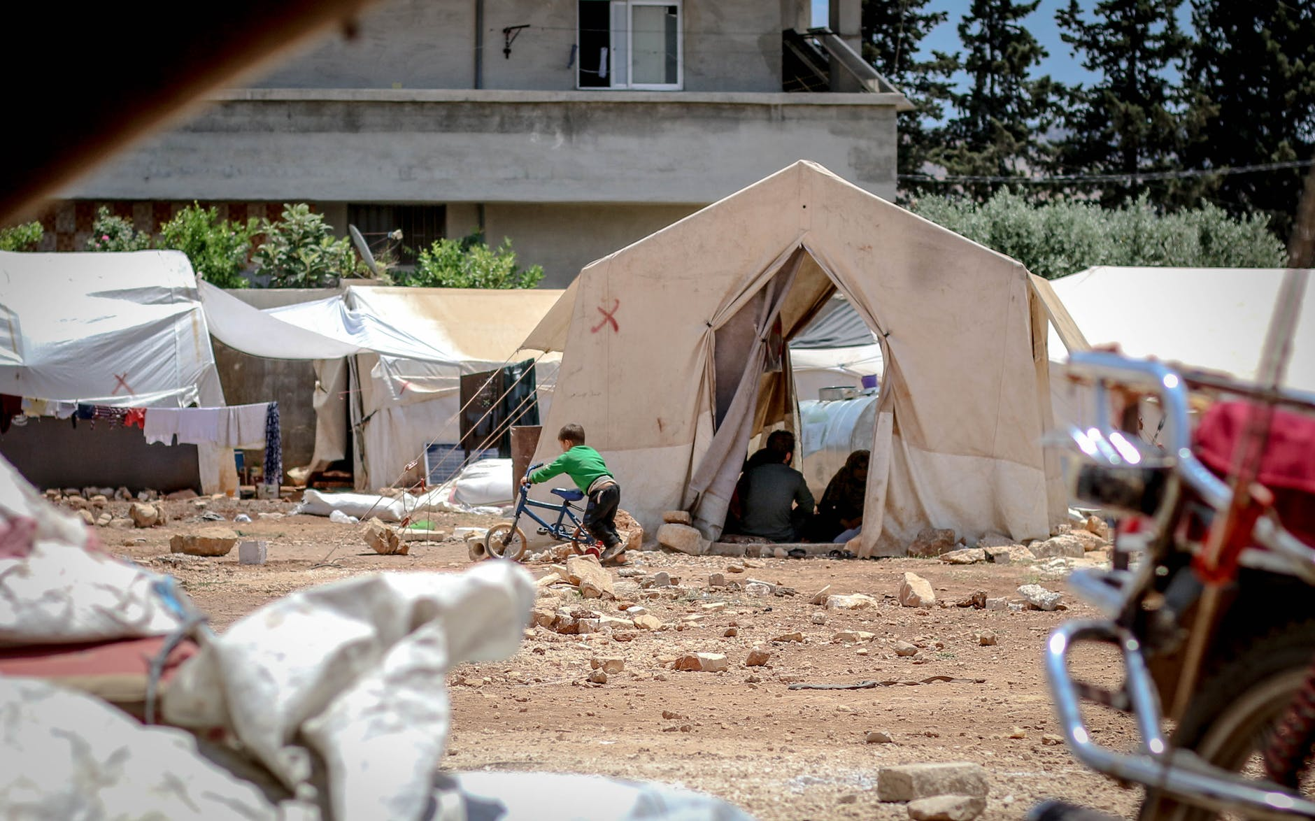 temporary tents on ground in daylight