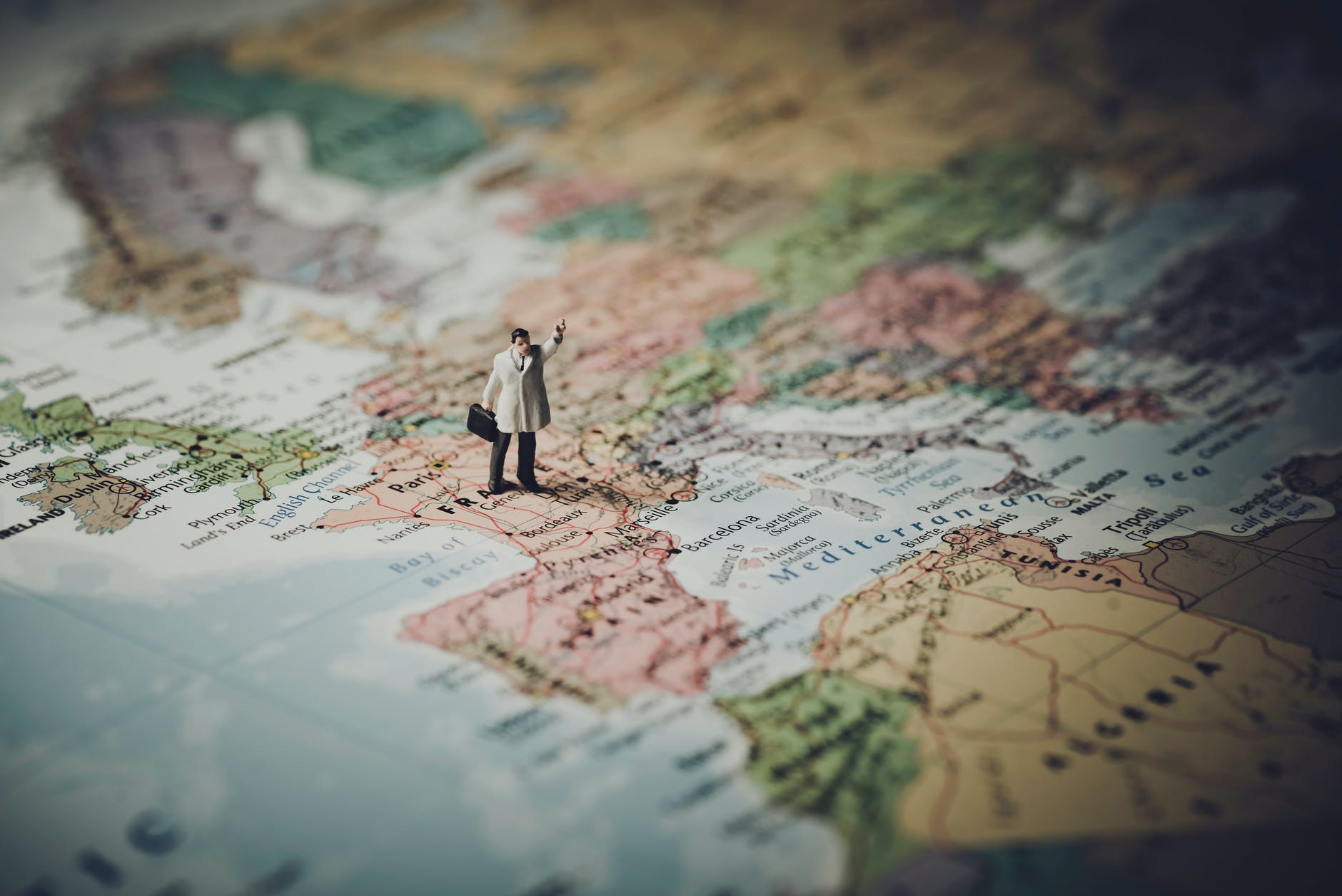 model figure standing on map