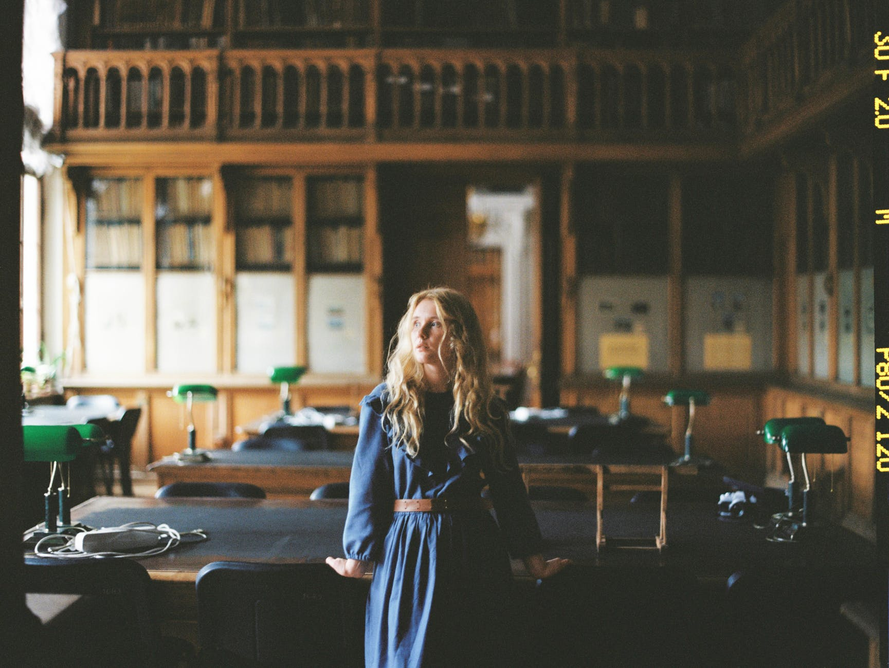 woman in blue dress in a library