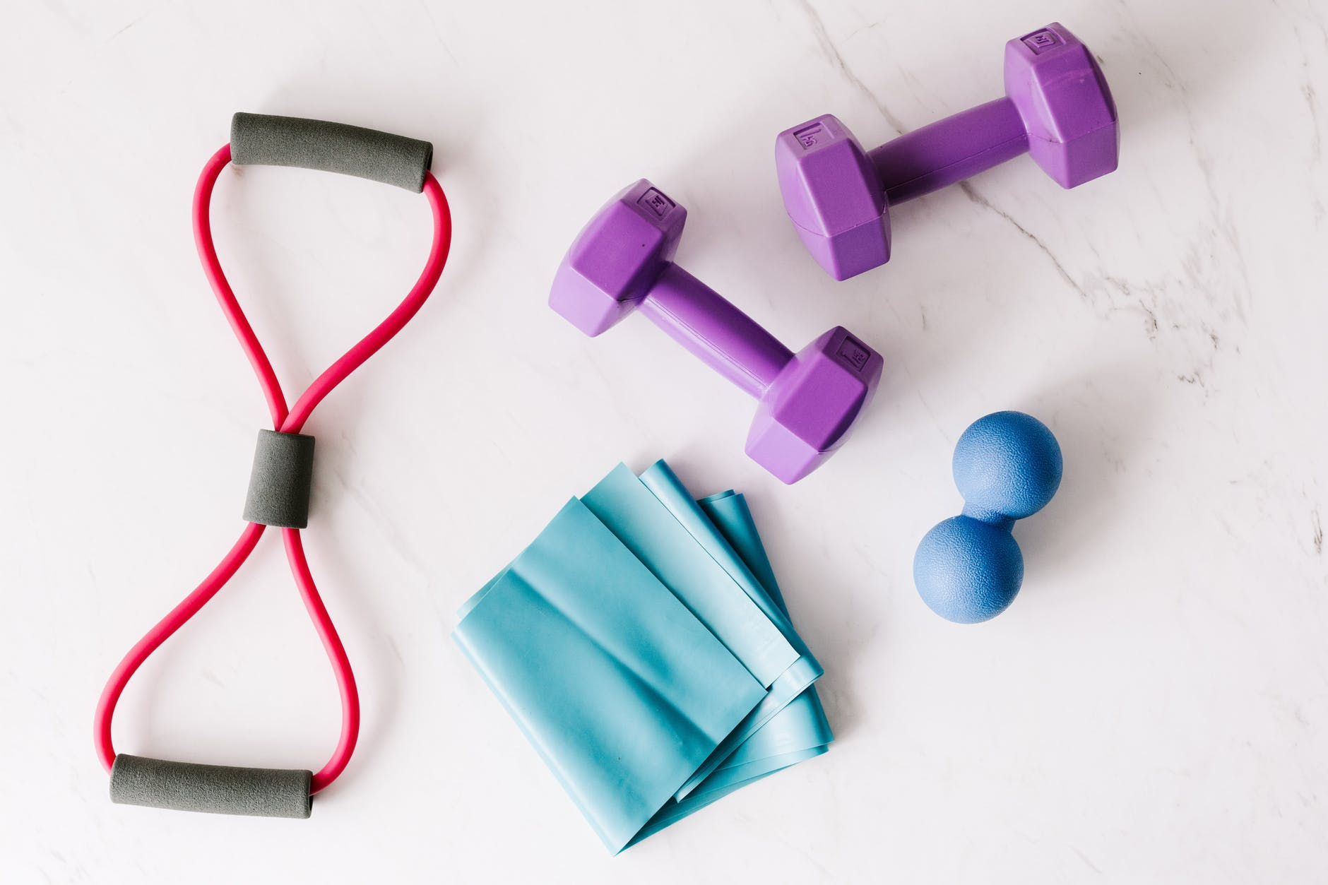 set of fitness equipment placed on marble surface
