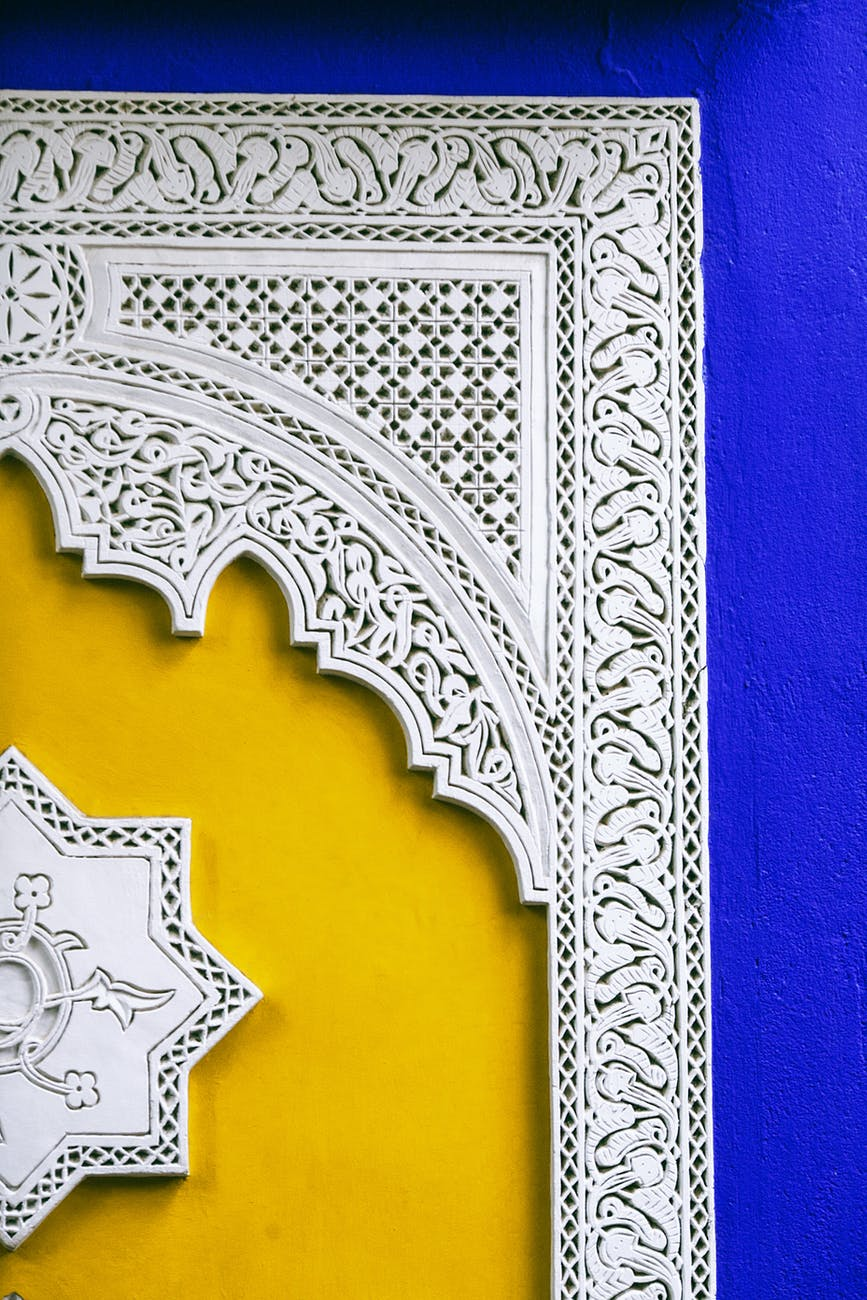 architectural ornament on bright old building wall